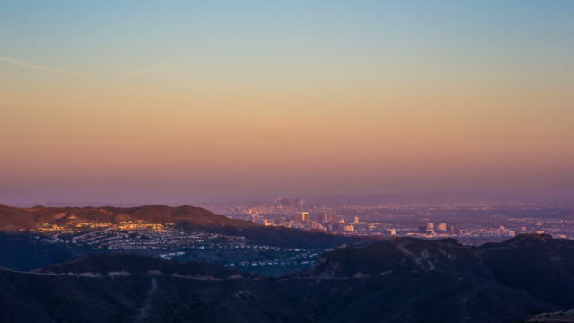downtown los angeles sunset as seen from malibu - collina video stock e b–roll