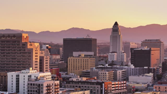 downtown los angeles with city hall at sunrise - drone shot - los angeles stock videos & royalty-free footage