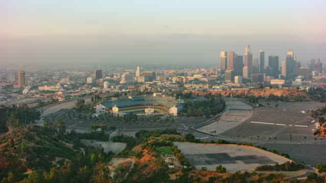 aerial downtown los angeles with dodger stadium in the front - real time stock videos & royalty-free footage