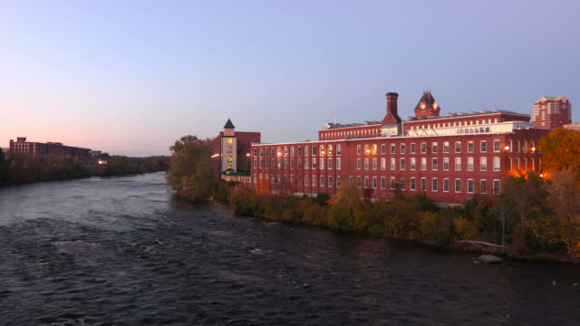 downtown manchester along the merrimack river - opificio video stock e b–roll