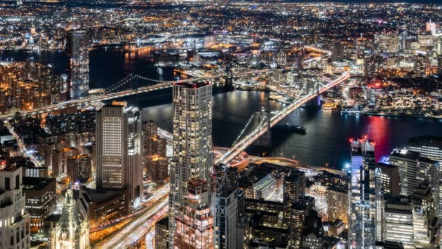 t/l ws ha zo downtown manhattan and brooklyn at night / new york city, usa - zoom out stock videos & royalty-free footage