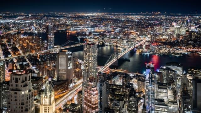 t/l ws ha downtown manhattan and brooklyn at night / new york city, usa - manhattan stock-videos und b-roll-filmmaterial