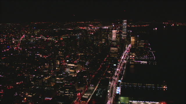downtown manhattan and freedom tower aerial view at night on the west side - tribeca stock videos & royalty-free footage