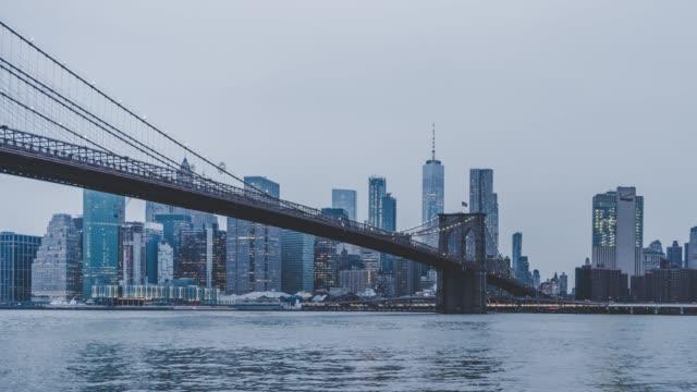 t/l td downtown manhattan, day to night transition / new york, usa - brooklyn bridge stock videos & royalty-free footage