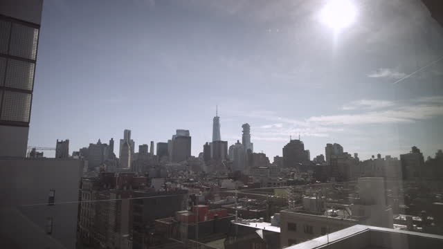 downtown manhattan from soho rooftop with one world trade center on a sunny afternoon in new york city, new york on may 01, 2021. - roof stock videos & royalty-free footage