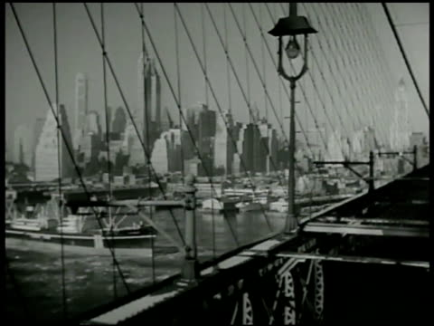 downtown manhattan highrise skyline from brooklyn bridge new york suburb ws new york unidentified borough nice two story homes curved street w/ man... - zweistöckiges bauwerk stock-videos und b-roll-filmmaterial