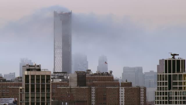 downtown manhattan sunrise with clouds. - varmt ljus bildbanksvideor och videomaterial från bakom kulisserna