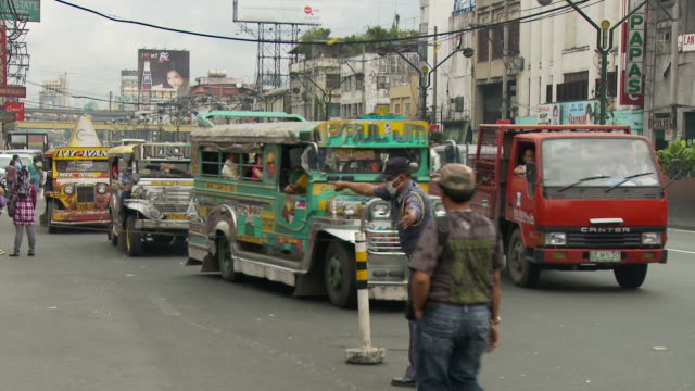 downtown manila street with jeepneys in philippines - philippines stock videos & royalty-free footage