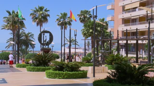 downtown marbella looking towards mediterranean, avenida del mar marbella, andalucia, spain - スペイン国旗点の映像素材/bロール