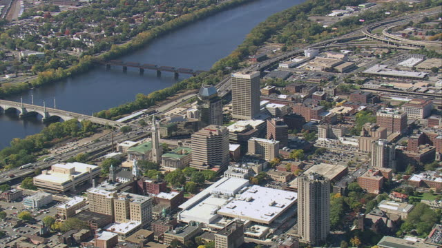 AERIAL Downtown metropolis, with Memorial Bridge crossing Connecticut River that dissects city / Springfield, Massachusetts, United States