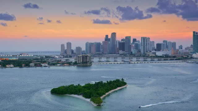 aerial downtown miami, fl at sunset from biscayne bay - biscayne bay stock videos & royalty-free footage