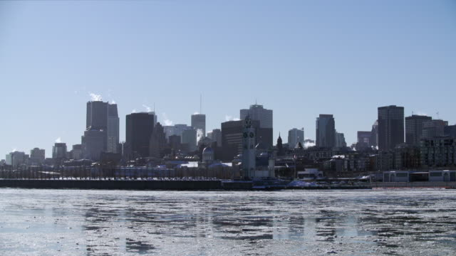 Downtown Montreal and St. Lawrence River in winter