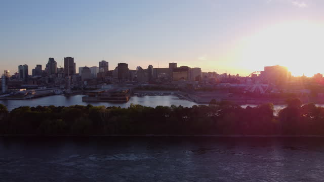 downtown montreal cityscape aerial view and st. lawrence river in summer at sunset - vieux montréal stock videos & royalty-free footage