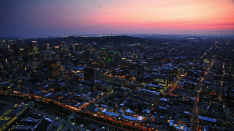aerial downtown montreal, qc, with lights on at dusk - canada stock videos & royalty-free footage
