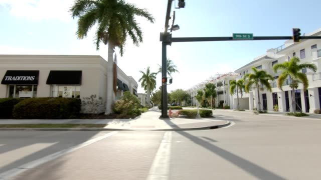 downtown naples xiv synced series left view driving process plate - naples florida stock videos & royalty-free footage