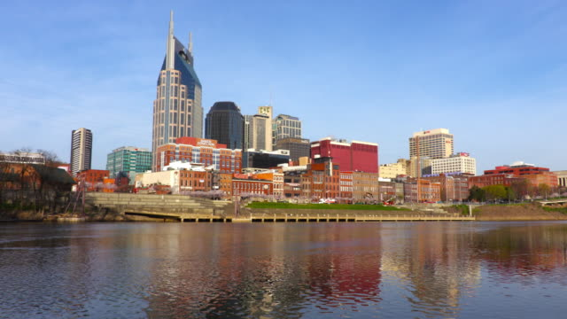 downtown nashville skyline along the cumberland river - nashville stock videos & royalty-free footage