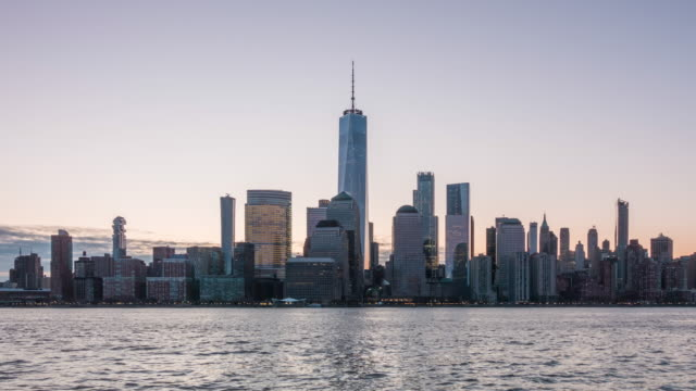 downtown new york city skyline in manhattan at sunrise - new york stato video stock e b–roll