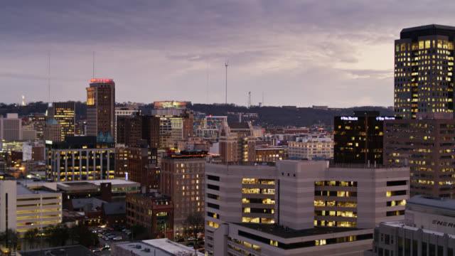 downtown offices and children's hospital in birmingham, alabama at dusk - birmingham alabama video stock e b–roll