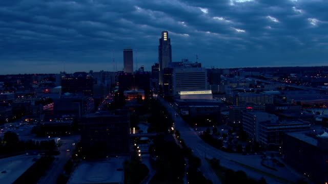 downtown omaha night cityscape featuring first national tower and woodmen tower - omaha stock videos & royalty-free footage