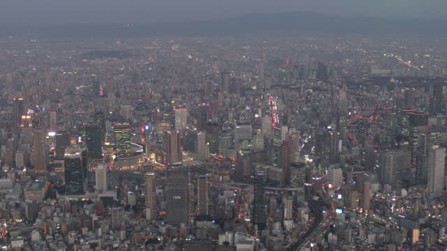 aerial, downtown osaka at dusk, osaka, japan - bahnhof osaka stock-videos und b-roll-filmmaterial