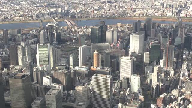 aerial, downtown osaka, japan - 大阪駅点の映像素材/bロール