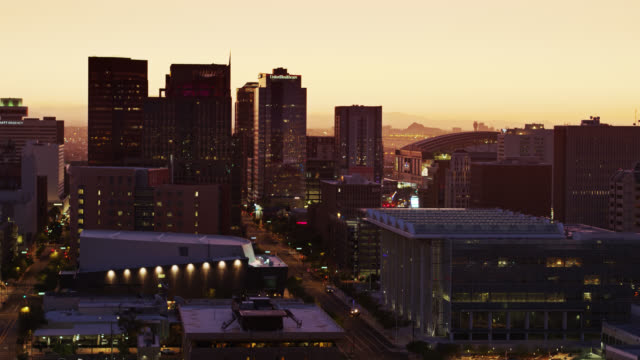downtown phoenix skyscrapers at sunrise - drone shot - arizona stock-videos und b-roll-filmmaterial