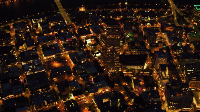 aerial downtown portland from the west bank of willamette river at night - portland oregon downtown stock videos & royalty-free footage