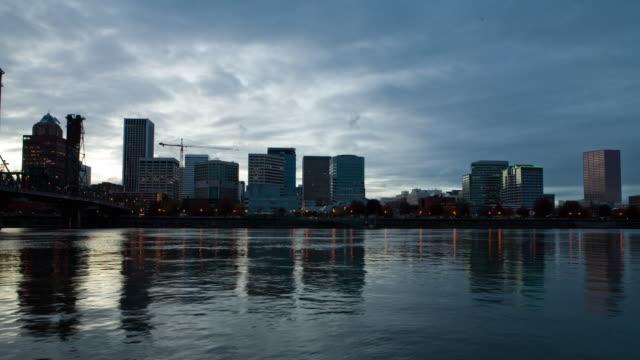 T/L WS Downtown Portland skyline seen across Willamette River, dusk to night / Oregon, USA
