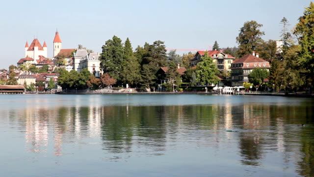 downtown reflections and lake thun, thun - lake thun stock videos and b-roll footage