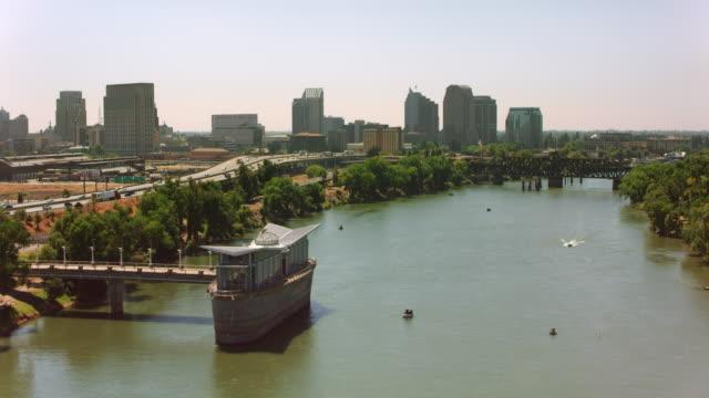 aerial downtown sacramento from the sacramento river, ca - sacramento stock videos & royalty-free footage