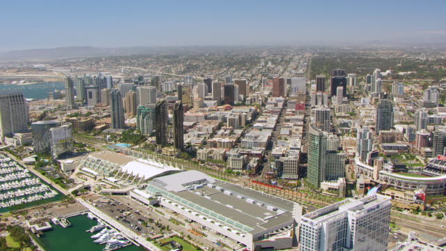 WS AERIAL POV Downtown San Diego along the bay with ballpark and convention center foreground / San Diego, California, United States