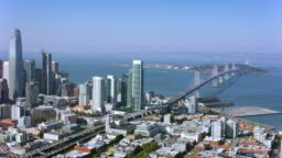 AERIAL Downtown San Francisco and the Bay Bridge on a sunny day