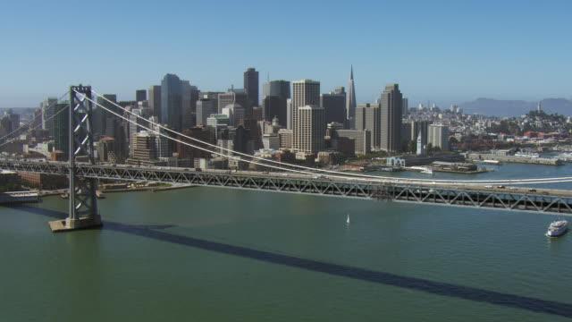 downtown san francisco with oakland bridge - 北半球点の映像素材/bロール