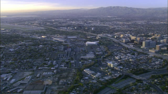 downtown san jose cityscape stretching into distance, including hp pavilion sports arena, low & high-rise buildings. ca, central business district - san jose california stock videos & royalty-free footage