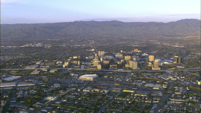 downtown san jose cityscape stretching into distance, including hp pavilion sports arena, high-rise buildings, mountains bg. ca, central business... - san jose california stock videos & royalty-free footage