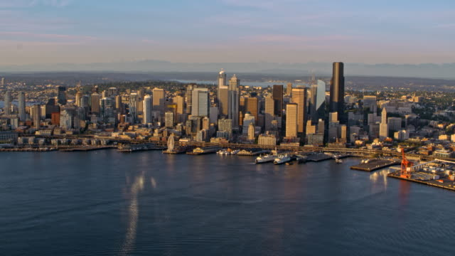AERIAL Downtown Seattle from Elliot Bay at sunset