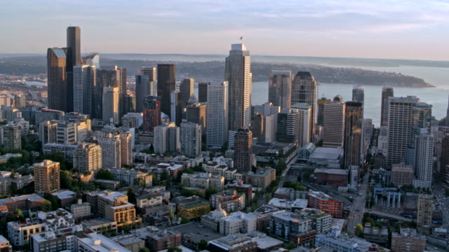 AERIAL Downtown Seattle overlooking the Elliott Bay at sunset