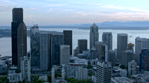 aerial downtown seattle with the elliott bay and harbor island - elliott bay stock videos & royalty-free footage