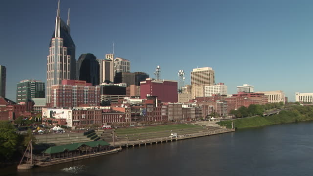 ws, downtown skyline across cumberland river, nashville, tennessee, usa - nashville stock videos & royalty-free footage