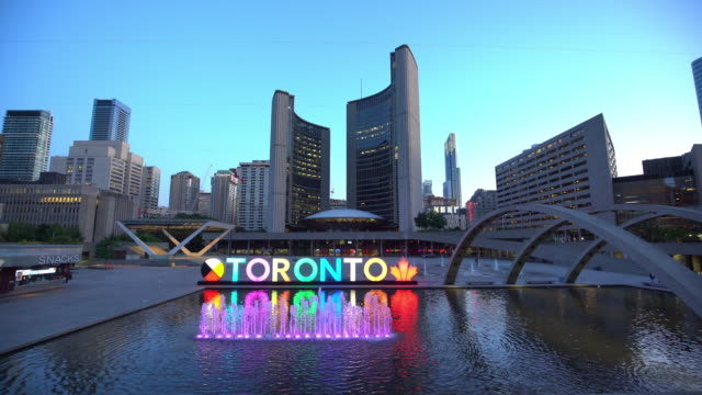 downtown skyline at nathan phillips square in toronto - famous place stock videos & royalty-free footage