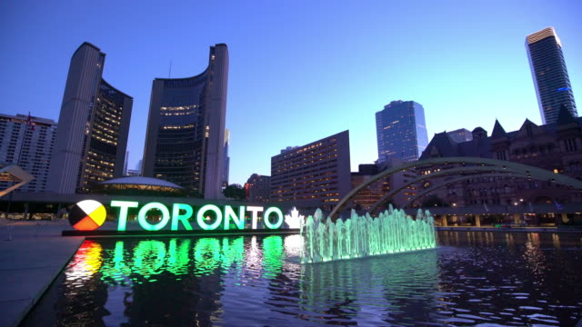 downtown skyline at nathan phillips square in toronto - toronto stock videos & royalty-free footage
