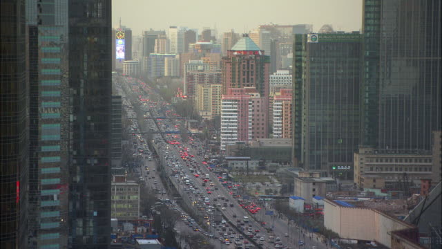 WS TU TD HA Downtown skyline with heavy traffic, Beijing, China