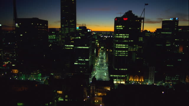 AERIAL Downtown skyscrapers and Martin Place illuminated at dusk / Sydney, Australia