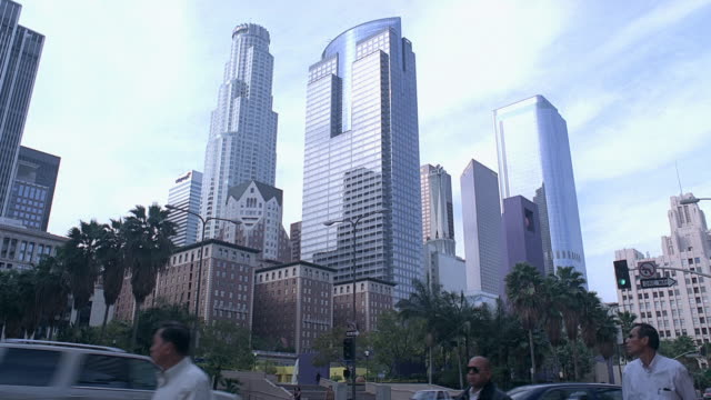LA Downtown skyscrapers looming over pedestrians and traffic / Los Angeles, California, United States