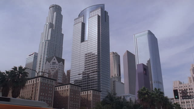 LA Downtown skyscrapers looming over smaller buildings / Los Angeles, California, United States