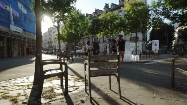 downtown street on sunny day - grenoble, france - heranzoomen stock-videos und b-roll-filmmaterial