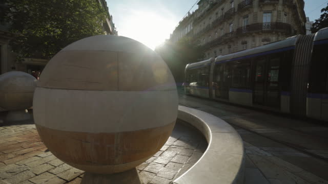 downtown street with mero rail on sunny day - grenoble, france - grenoble stock-videos und b-roll-filmmaterial