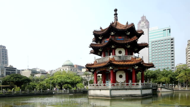 Downtown Taipei Peace park pagoda with pond on a sunny day HD video