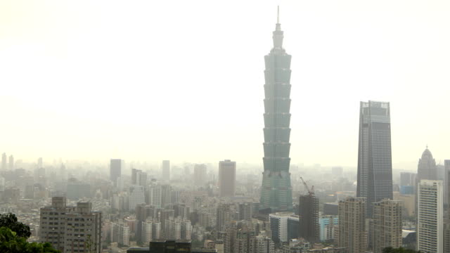 downtown taipei skyline daytime on a smoggy day 4k video panning version - taiwan stock videos & royalty-free footage