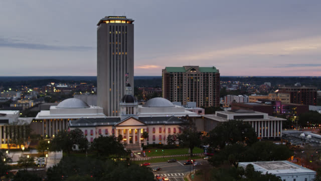 downtown tallahassee and florida state capitol at dusk - aerial - florida us state stock videos & royalty-free footage